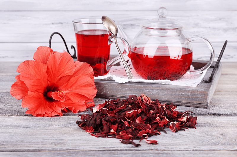 hibiscus tea in glass cup and teapot