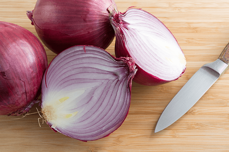 red onion on a cutting board