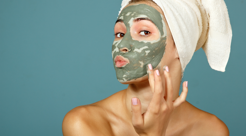 Woman looking confused with green face mask.