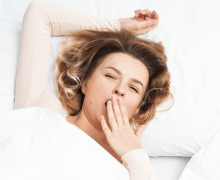 woman stretching and yawning