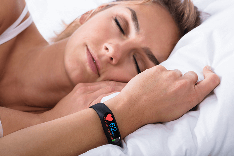 Woman sleeping with fitness tracker on