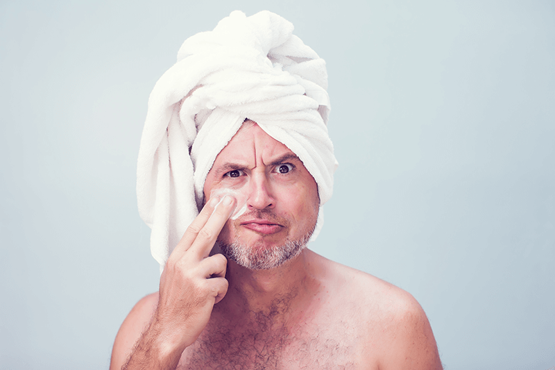 man with towel on head