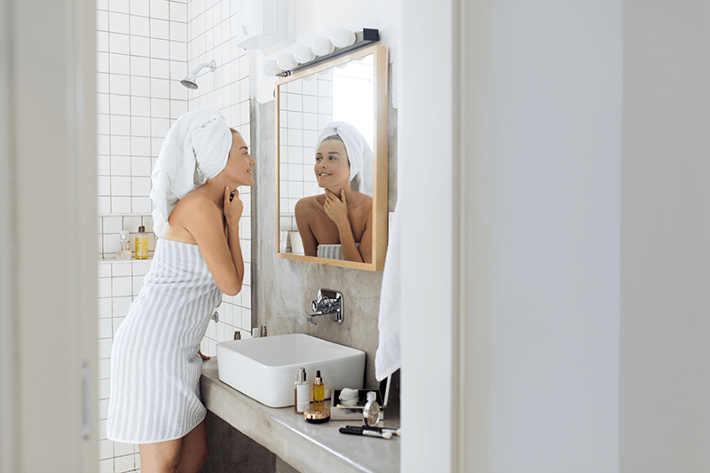 woman using anti-aging products in the bathroom