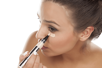 applying concealer