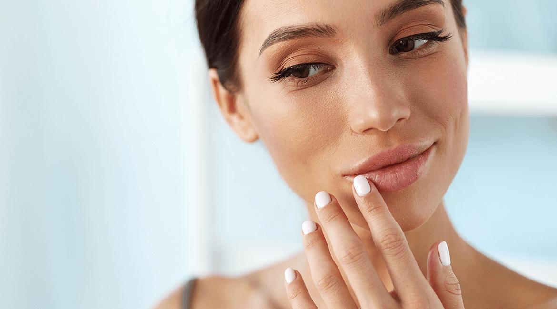 woman admiring lip fillers