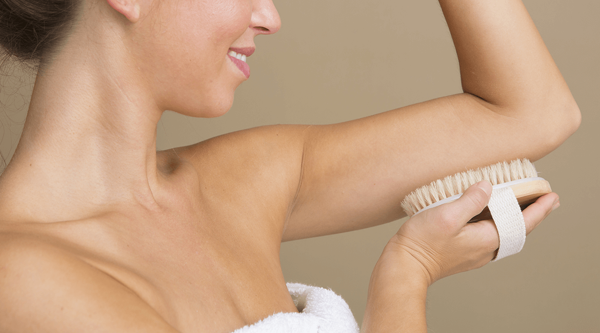 woman dry body brushing