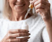 woman holding moisturizer