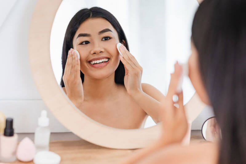 woman practicing skin care routine