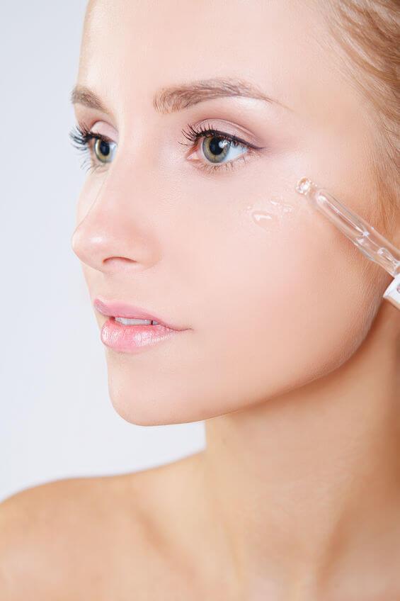skin serum on face