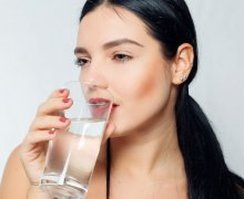 woman drinking water for skin benefits